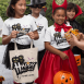 halloween-mockup-of-kids-with-t-shirts-and-tote-bags-asking-for-trick-or-treat-29323.png